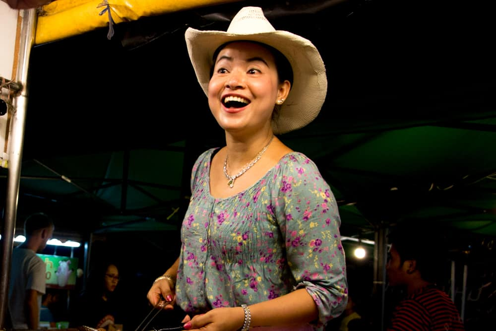 The Cowboy Hat Lady is famous in Chiang Mai both for her hat and her tasty Khao Kha Moo. What to Eat in Chiang Mai - A Chiang Mai Food Guide 2foodtrippers