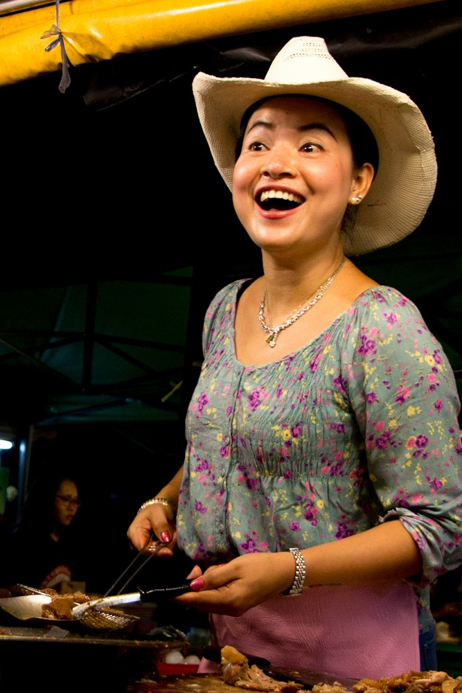 The cowboy hat lady serves up a mean dish of Khao Kha Moo at the Chang Phuak night market. See why she's one of the best street food vendors in Chiang Mai Thailand.