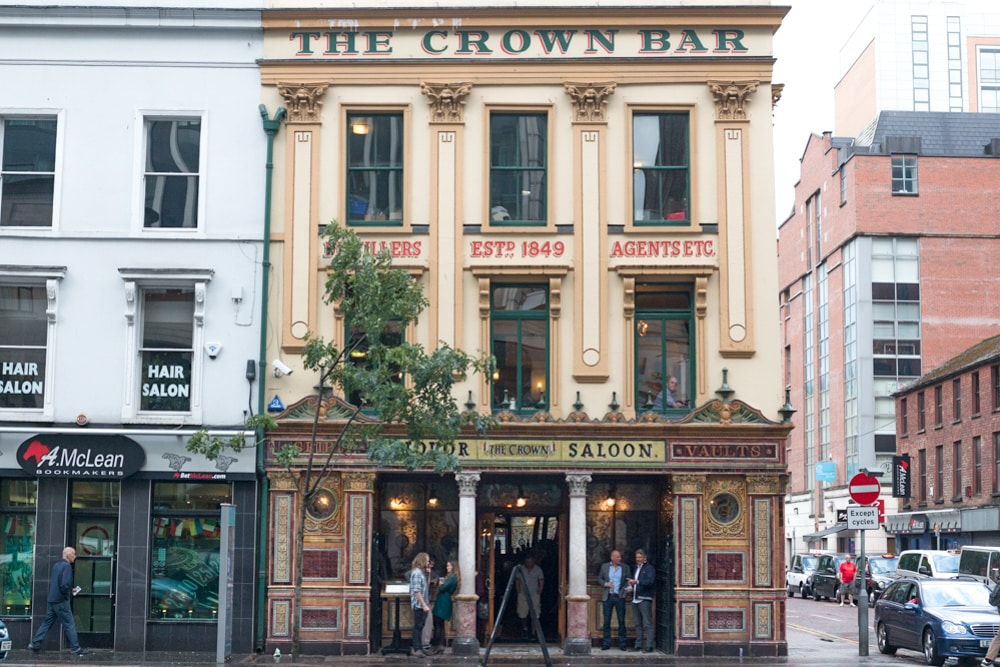 A visit to Belfast's Crown Liquor Saloon is a tippler's trip back in time. The historic building is located downtown directly across from the Europa Hotel. Belfast Food Guide Where to Eat in Belfast