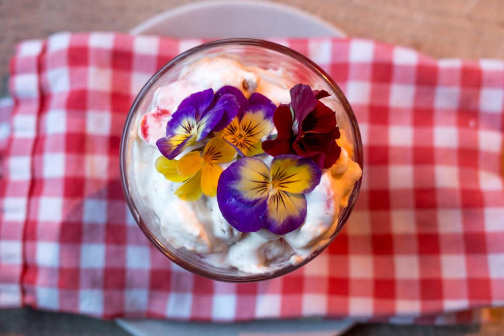 This dessert is called Trish McCambridge's Strawberry + Mess. We may not be the world's biggest fans of edible flowers, but they surely make this tasty dessert look extra pretty. Culinary Road Trip through Western Ireland. Kai Cafe + Restaurant Galway