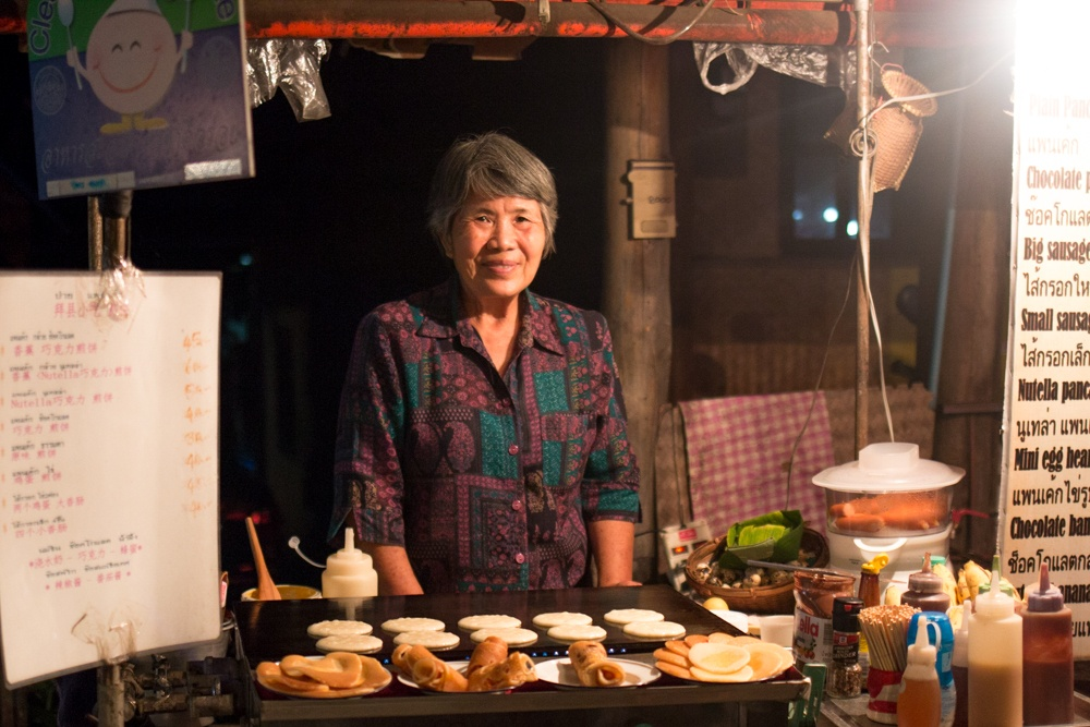 True confession - This night market vendor was actually in Pai where we did a two-day excursion from Chiang Mai. Boy oh boy did we love Grandmas and her Nutella-filled pancakes. What to Eat in Chiang Mai - A Chiang Mai Food Guide 2foodtrippers