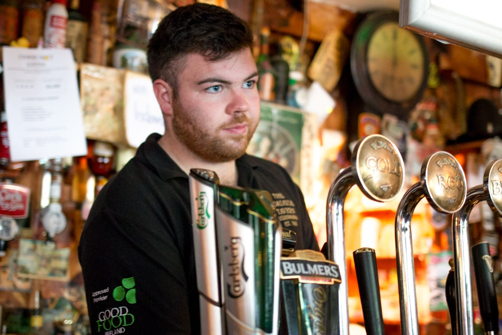 This bartender in Lisdoonvarna stood ready to serve us a fine Irish ale. Who were we to say no? Culinary Road Trip through Western Ireland. The Roadside Tavern