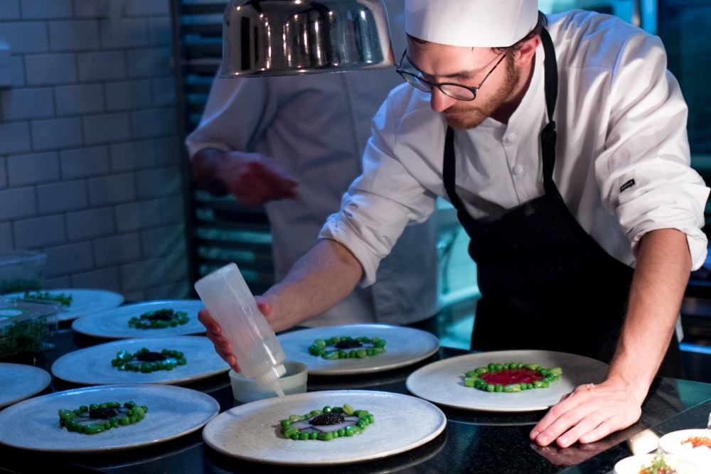 The open kitchen concept at Ambiance à Vindåkra provides a front row view of the restaurant's culinary artistry. Gastronomic Tour of Southern Sweden in Skåne