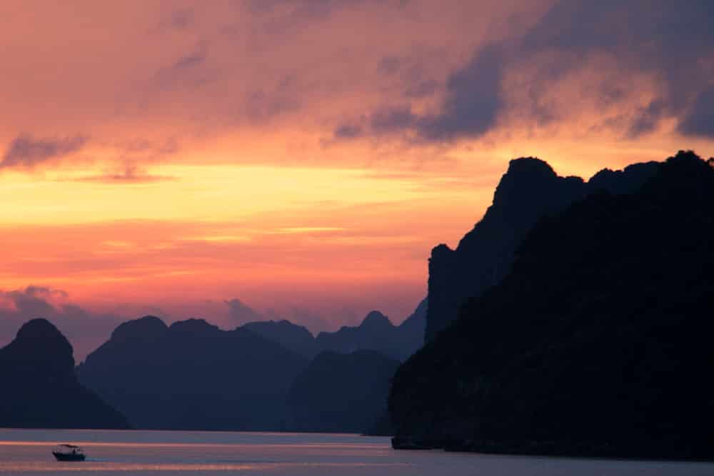 The sunset on our first night may be the best sunset we've ever seen. It was pure magic. Cruising Halong Bay Vietnam