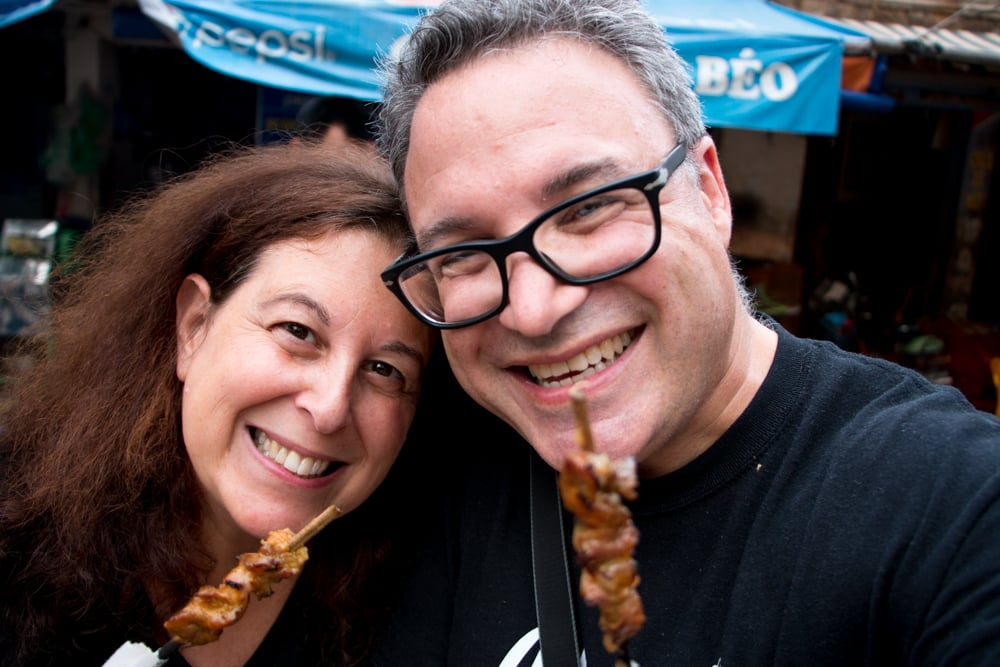 The 2foodtrippers enjoy the ever-popular meat on a stick on the Hanoi streets. What to Eat in Hanoi - A Hanoi Food Guide