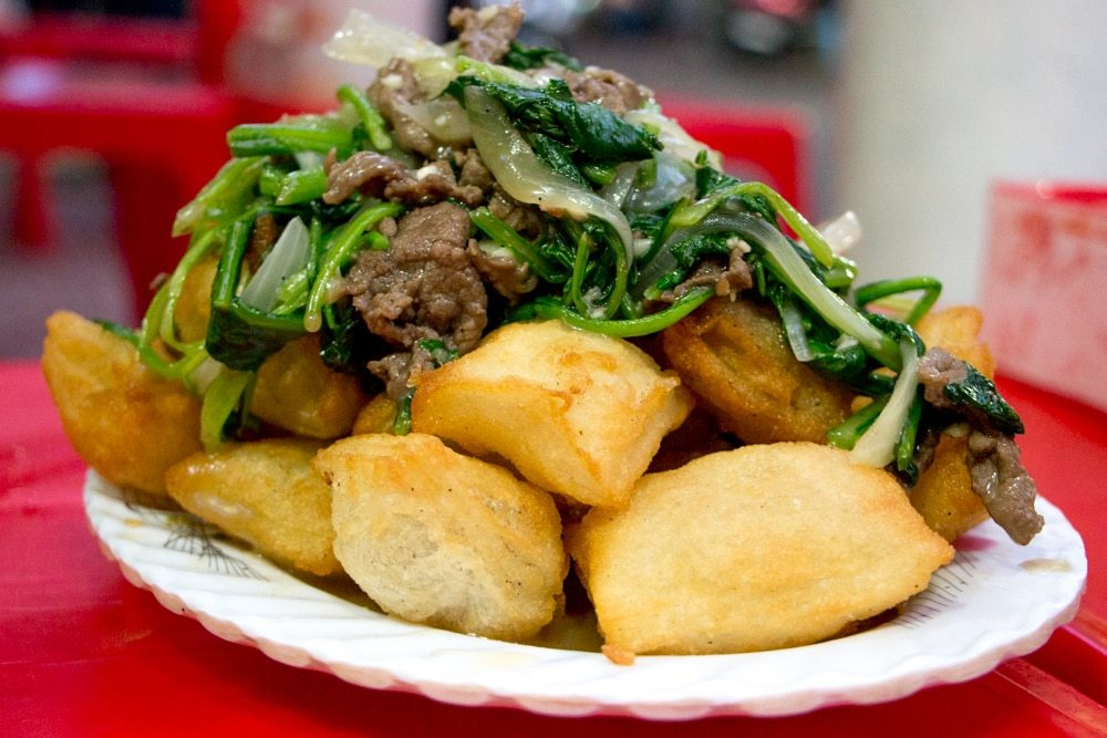 Pho Chien Phong are technically fried pho squares with beef gravy and vegetables, but we prefer to call them pillows of yumminess. What to Eat in Hanoi - A Hanoi Food Guide