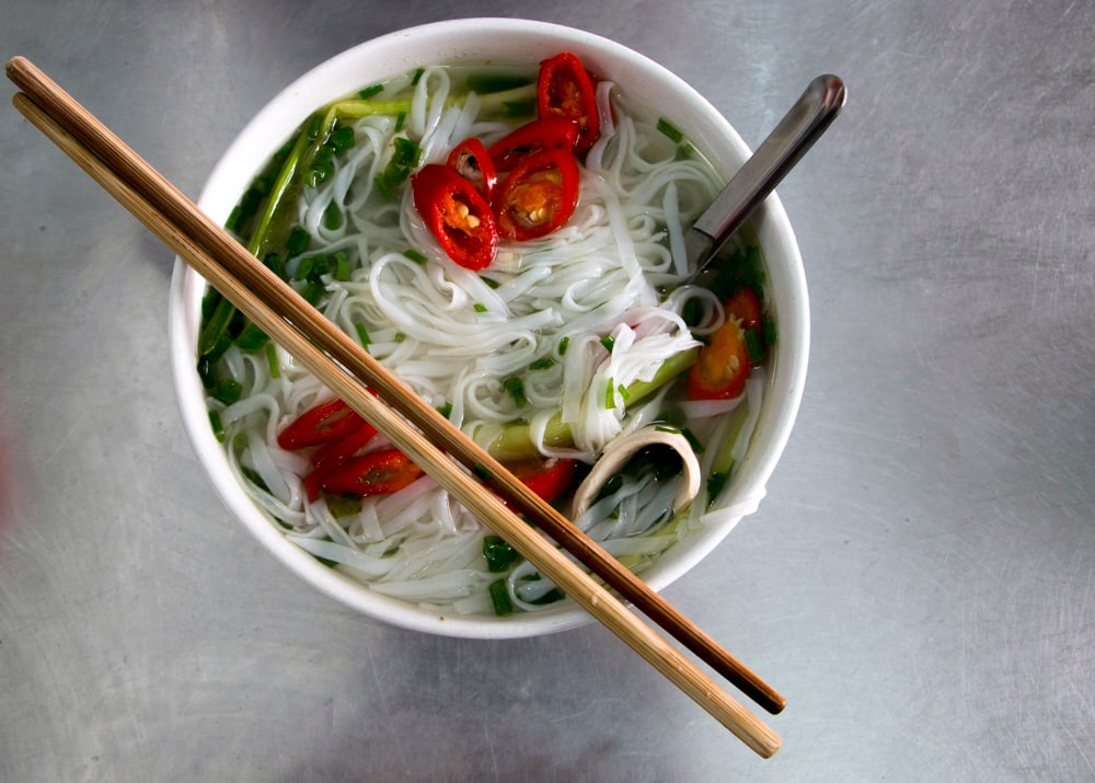 Bowl of Chicken Pho with Chopsticks in Hanoi Vietnam
