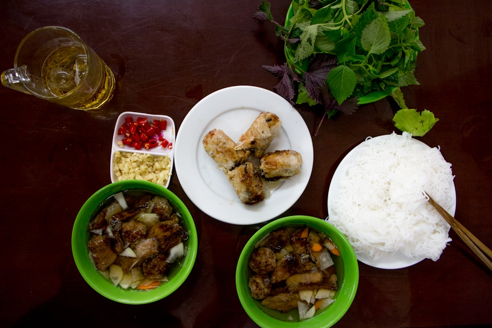 Don't miss Bun Cha, a local Hanoi creation. Our Bun Cha meal was quite a feast as pictured here. What to Eat in Hanoi - A Hanoi Food Guide