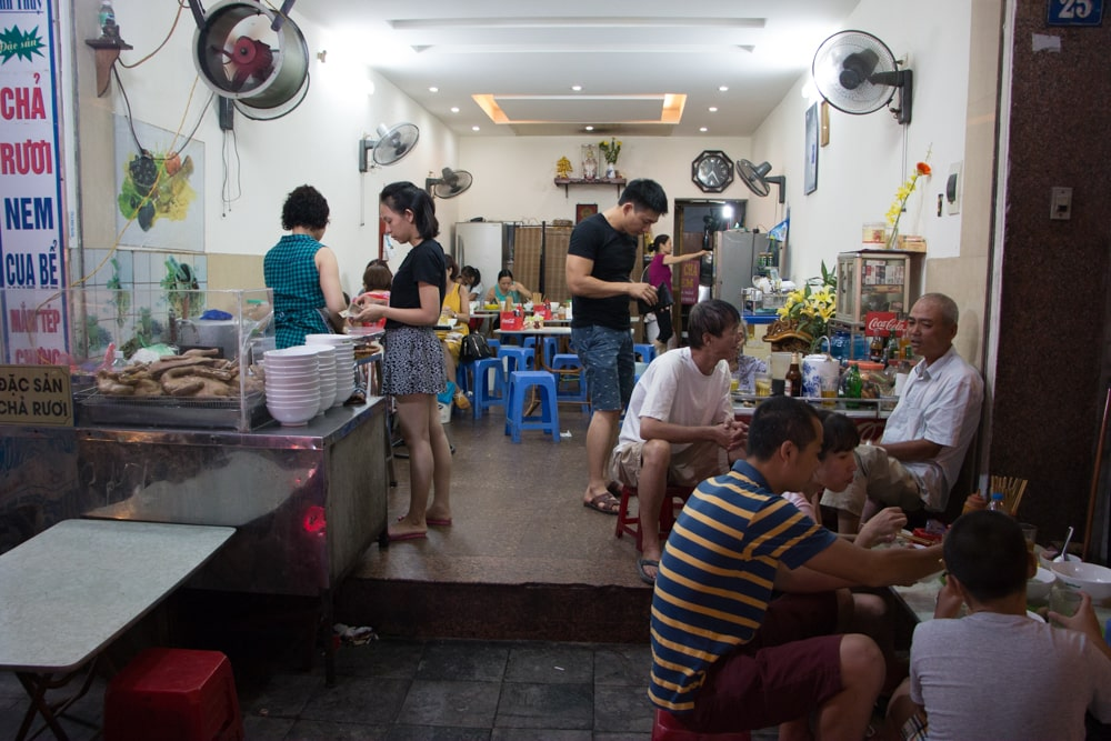 Expect open air dining at knee high tables and plastic stools at typical Hanoi restaurants. Dress code = t-shirts and shorts. What to Eat in Hanoi - A Hanoi Food Guide