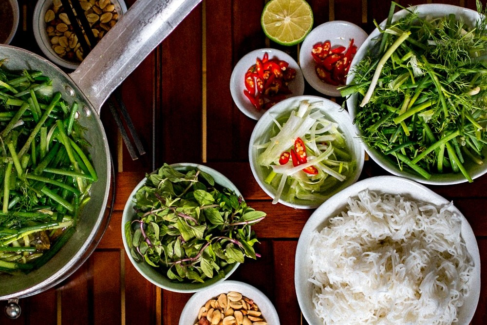 Eating Cha Ca in Hanoi is an interactive experience best enjoyed with friends over a leisurely meal. What to Eat in Hanoi - A Hanoi Food Guide