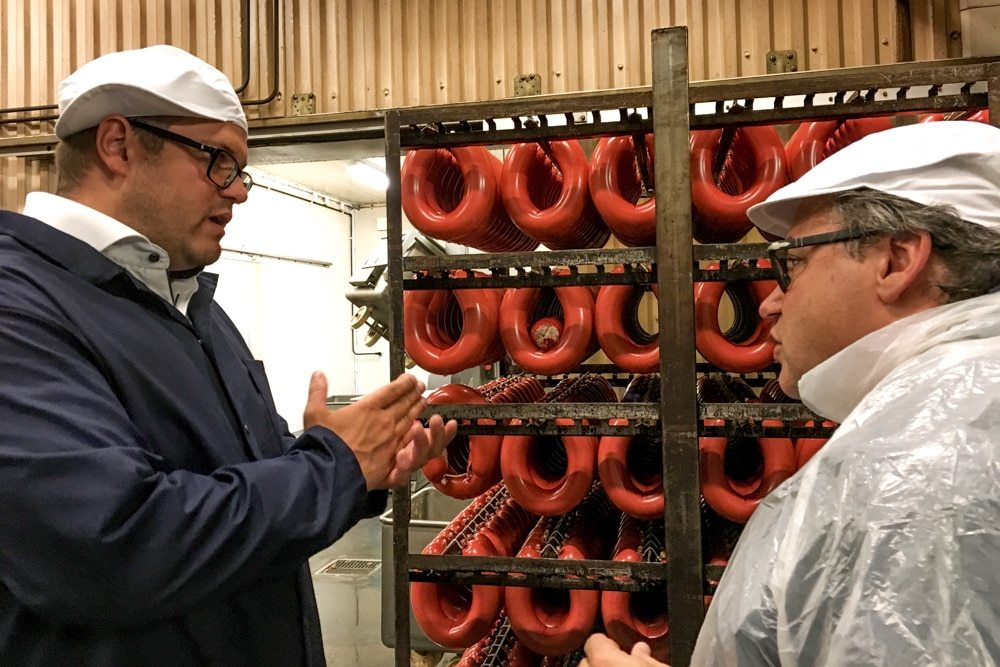 Daryl discusses sausage with owner Johan Lindqvist at Sorunda Korvfabrik, a sausage factory in Nynashamn. Tasting the Flavors of the Archipelago in Nynashamn Sweden