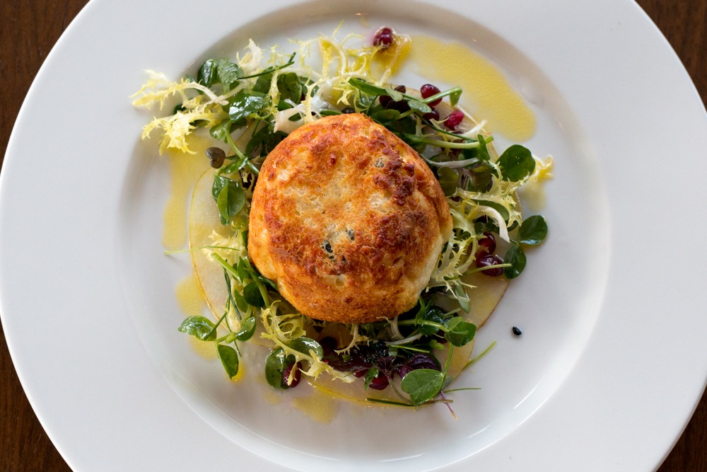 The Cornish Blue Twice-Baked Soufflé served over greens with a Gooseberry Vinaigrette starter incorporates local products in this thoroughly modern dish. Experience London from Above and Below