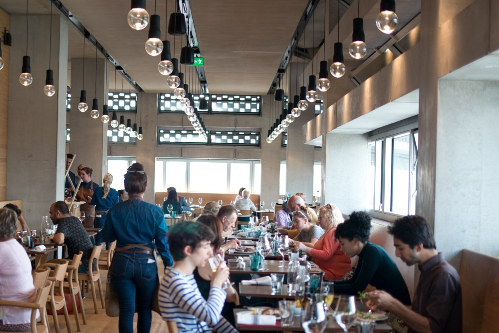 The dining room at the Restaurant at the Tate Modern has extraordinary views. Note all the windows, not to mention the happy diners. Experience London from Above and Below