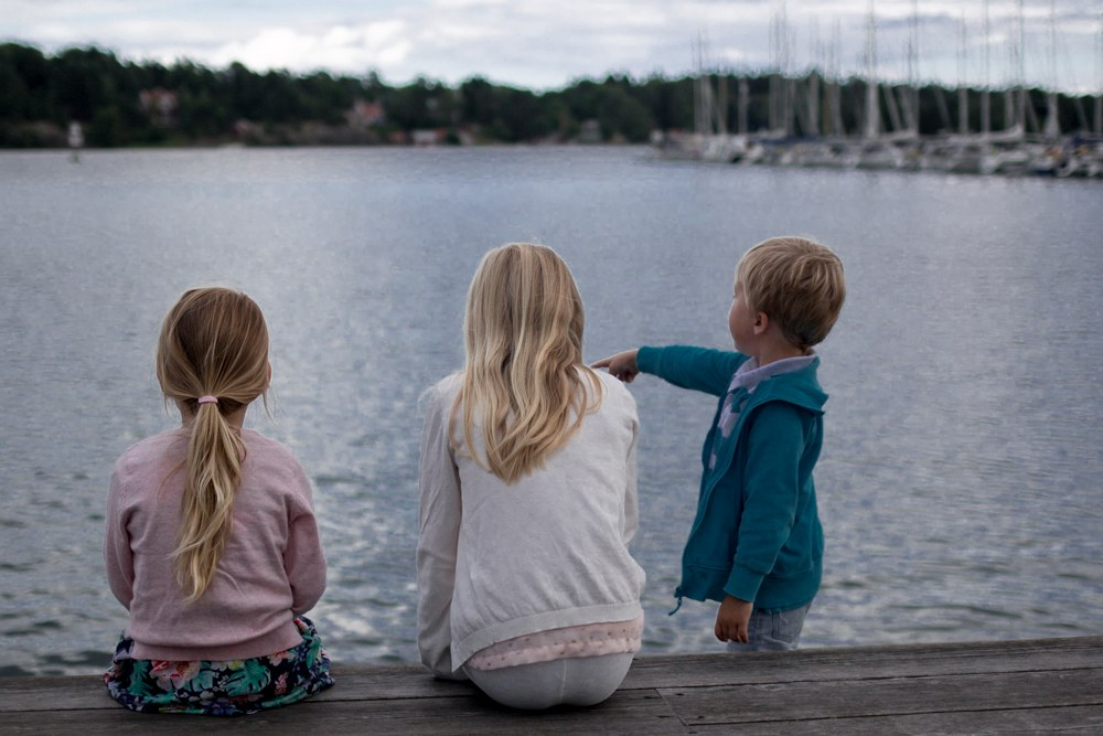Young locals enjoy the view of Nynashamn's pretty harbor