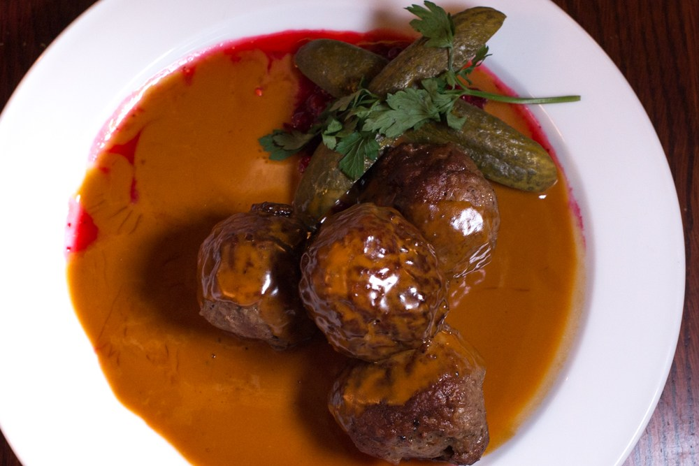 Restaurant Pelikan prepares Swedish Meatballs with both beef and pork and serves them with a savory gravy and lingonberries. Not pictured is the heaping plate of mashed potatoes that came with the meatballs. Why We Want to Plan Another Stockholm Trip
