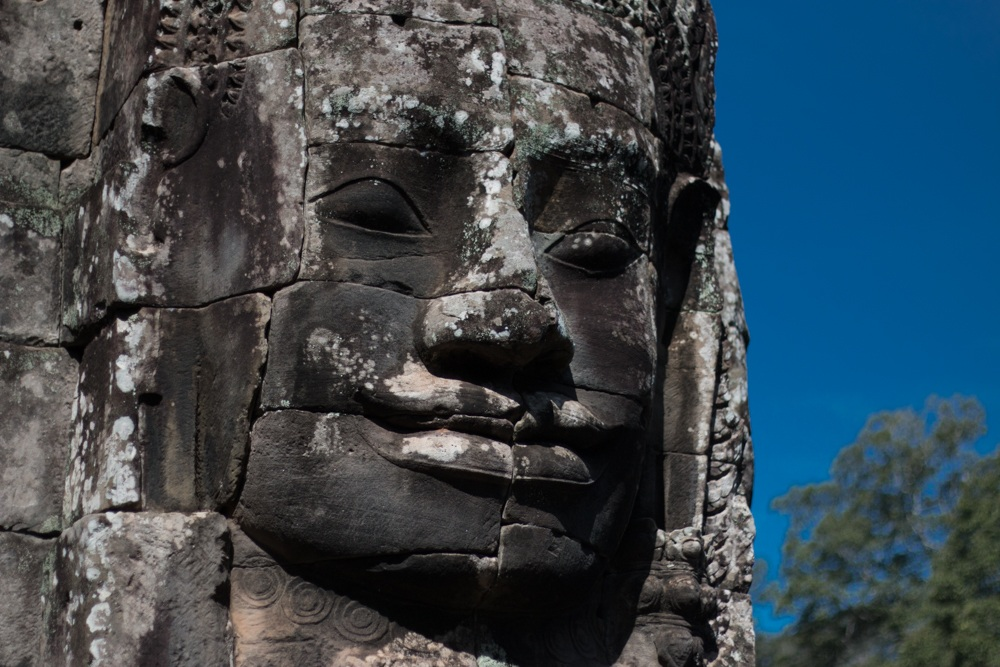 One of the 200 faces at Bayon Temple looked down on us as we explored the epic site. Cambodian Adventure in Siem Reap