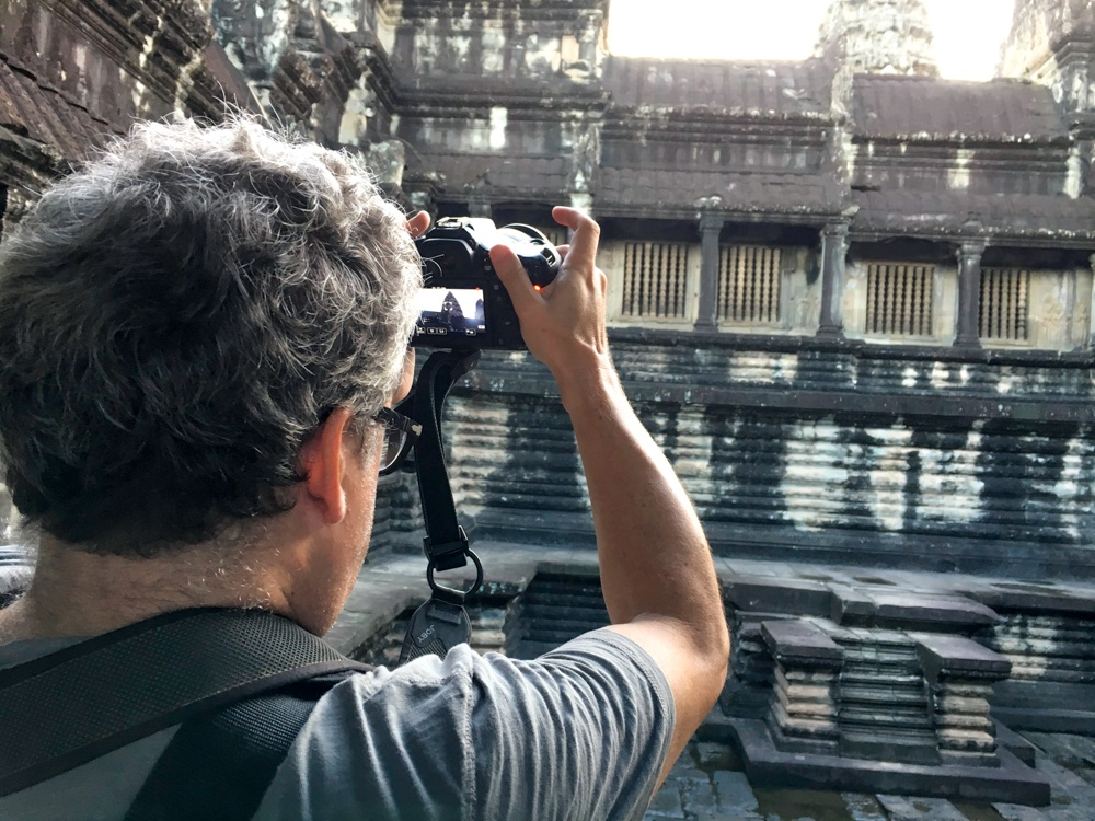 Angkor is a photographer's dream. Here is Daryl living out the dream at Angkor Wat. Cambodian Adventure in Siem Reap