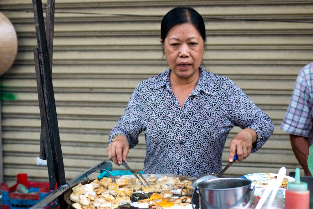 This street vendor cooks up a mean Bot Chien. We liked it so much that we came back for seconds. How To Eat in Saigon Food- A Ho Chi Minh City Food Guide