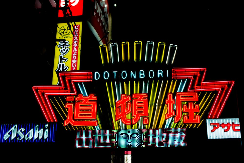 The neon lights shine bright on Dotonburi Street in downtown Osaka. Why You Gotta Visit Osaka Japan 2foodtrippers