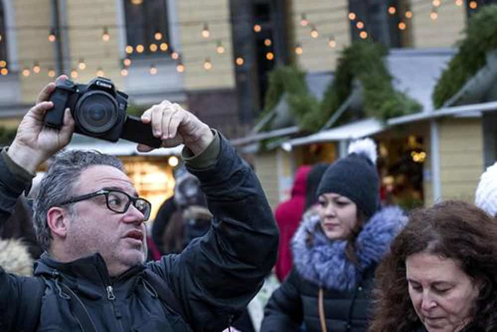 Photo of 2foodtrippers at the Helsinki Christmas Market Courtesy of Helsingin Sanomat