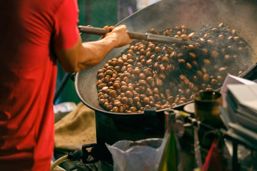 Roasting Chestnuts at a Bangkok Night Market
