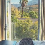 Pinterest image: image of hotel room with caption 'Franschhoek Boutique Hotelt'
