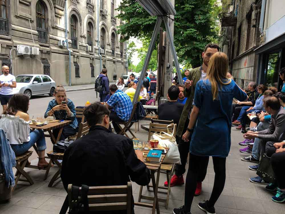 Origo Coffee Sidewalk Scene in Bucharest Romania
