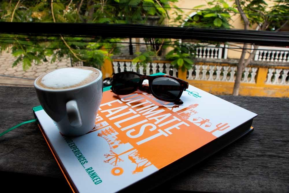 Lonely Planet Ultimate Eatlist with Coffee and Sunglasses