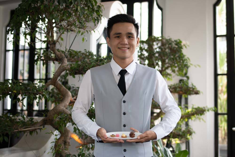 Server at at La Maison 1888 in Da Nang Vietnam