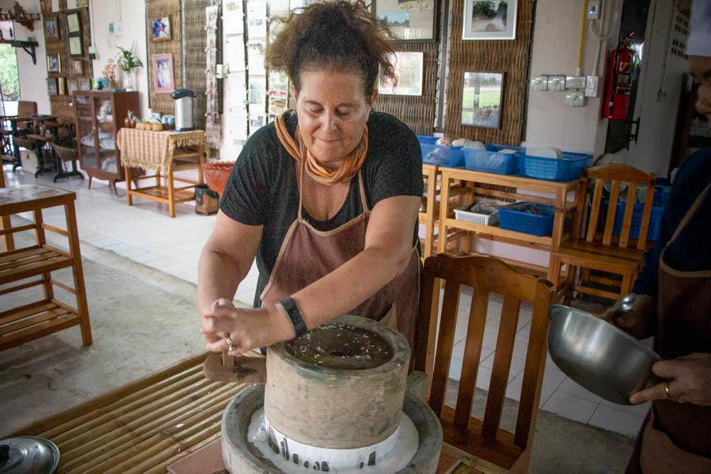 Mindi Grinds Rice at Love Chiang Mai Cooking Class