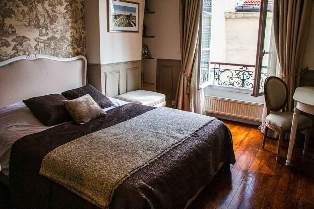 Bedroom in Cobblestone Paris Apartment Hotel