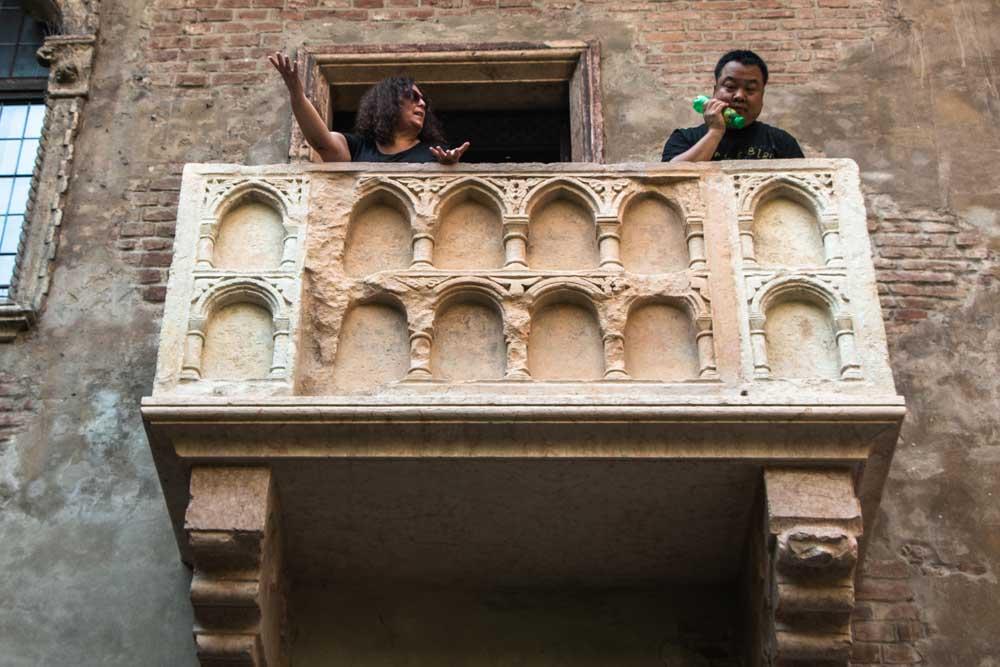 Mindi and Asian Man on Juliets Balcony in Verona Italy