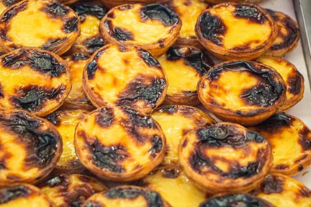 Pile of Pasteis de Nata at Manteigaria in Lisbon