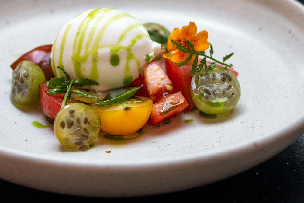 Goats Milk Ice Cream over Tomato Salad at BAK Restaurant in Amsterdam