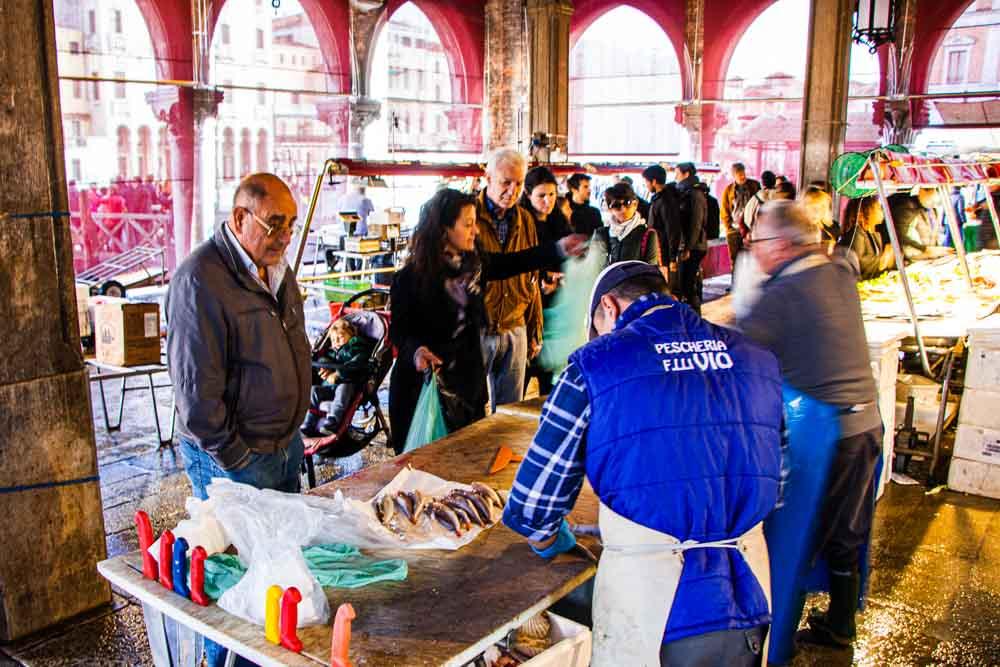 Fish Monger at Mercato di Rialto in Venice