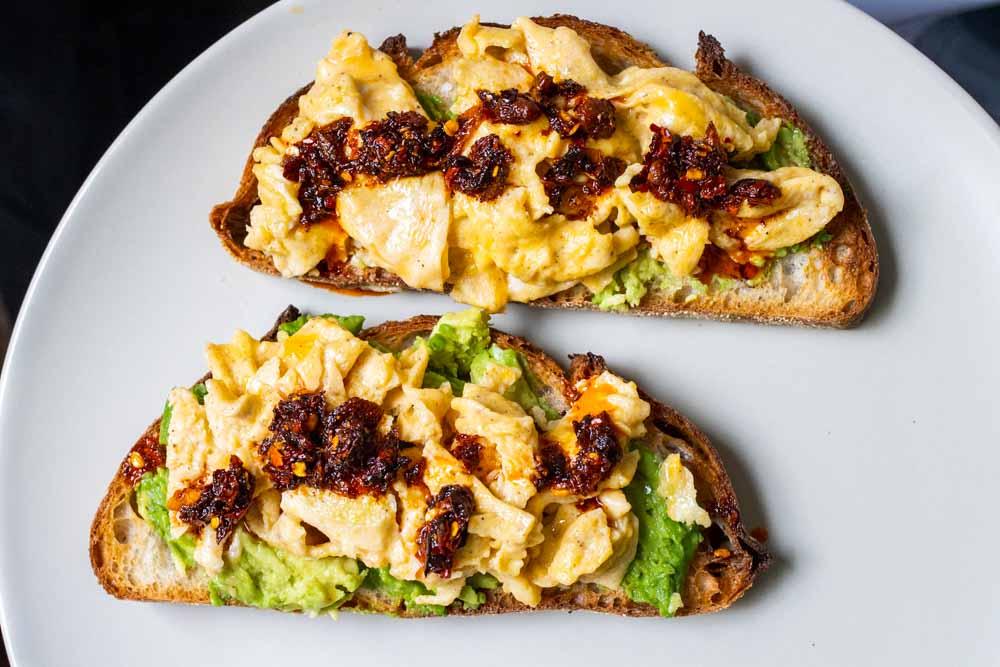 Avocado Egg Toast with Chili Crisp on Plain Plate