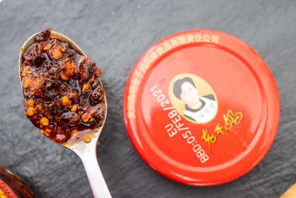 Chili Crisp on Spoon Next to Lid