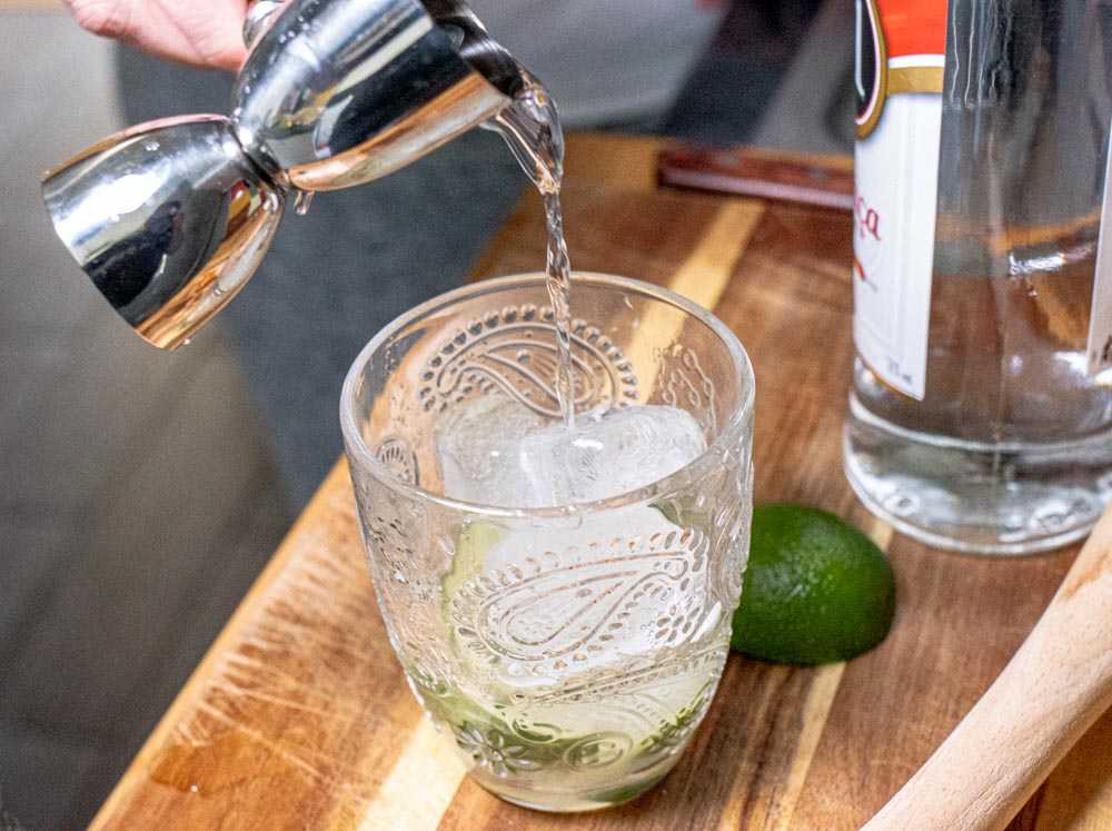 Pouring Cacacha into the Caipirinha
