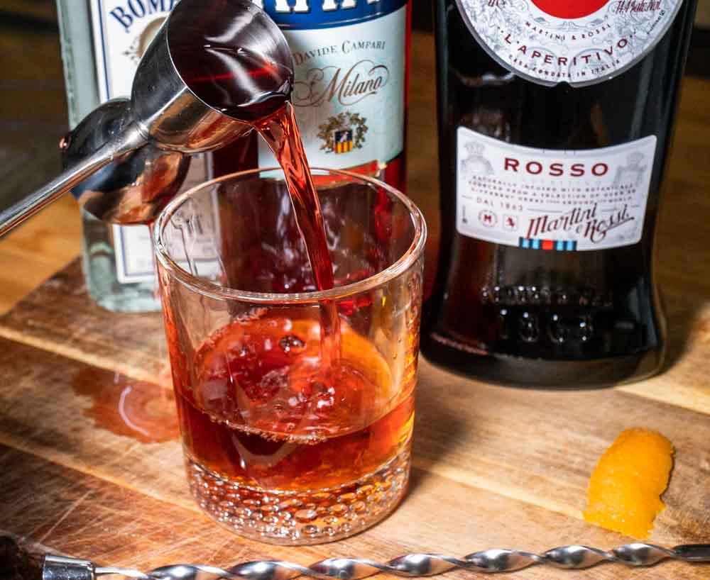 Pouring Campari for Negroni