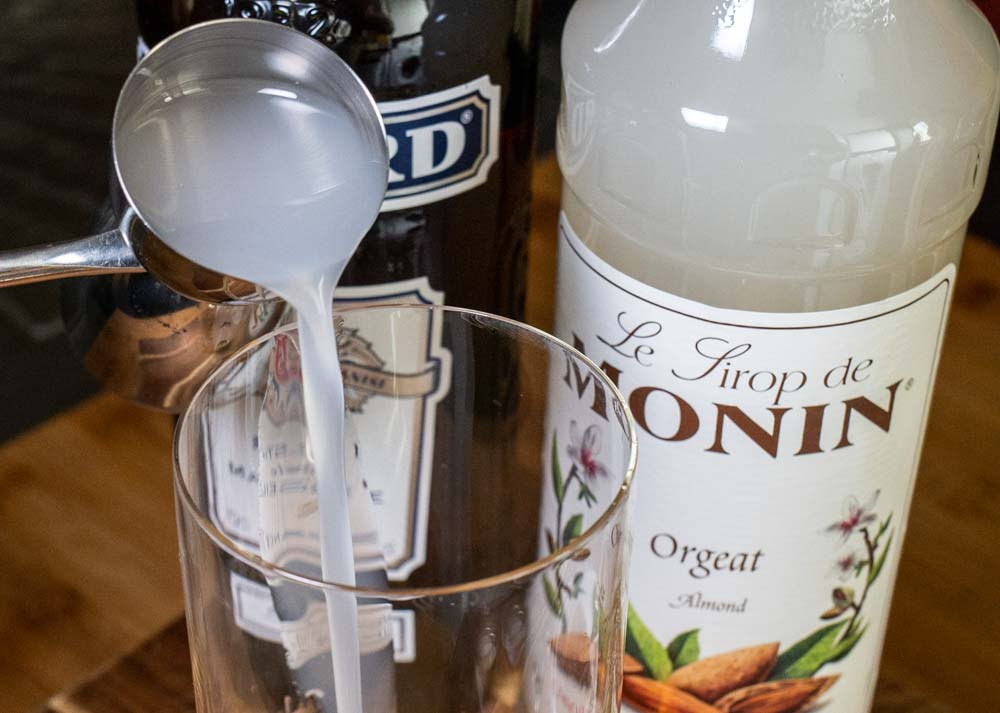Pouring Orgeat for Mauresque Cocktail