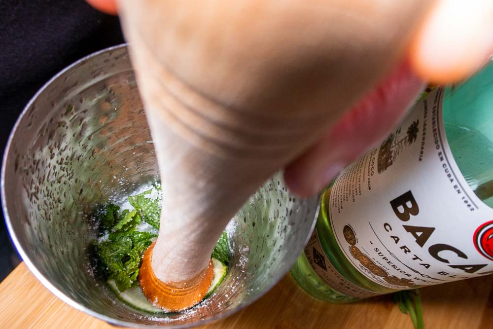 Muddling Mojiton in a Cocktail Shaker