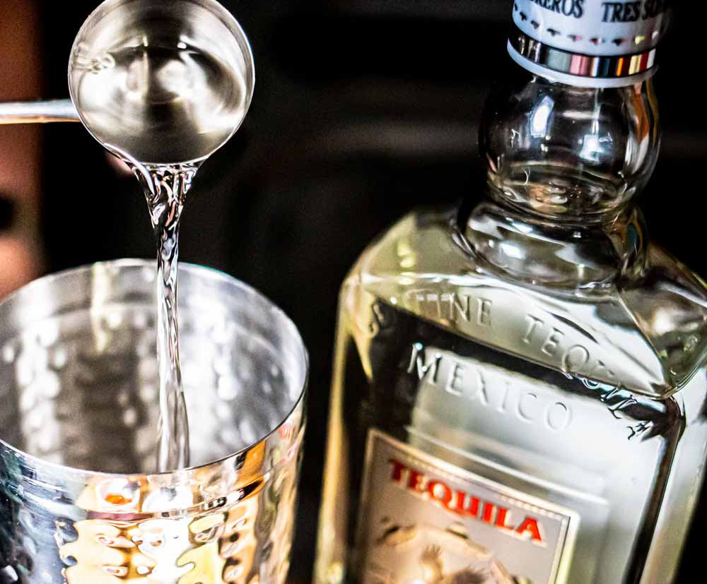 Pouring Tequila for Spicy Margarita Recipe