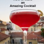 "Pinterest image: clover club cocktail on ledge with caption reading ""Clover Club How to Make an Amazing Cocktail"""