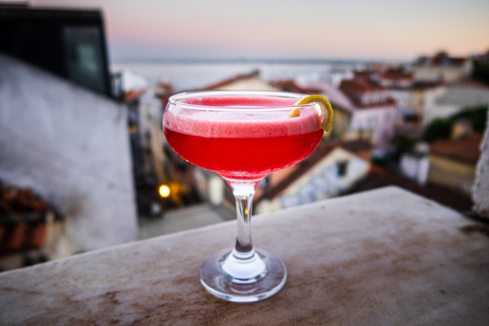 Clover Club Cocktail on Ledge at Night