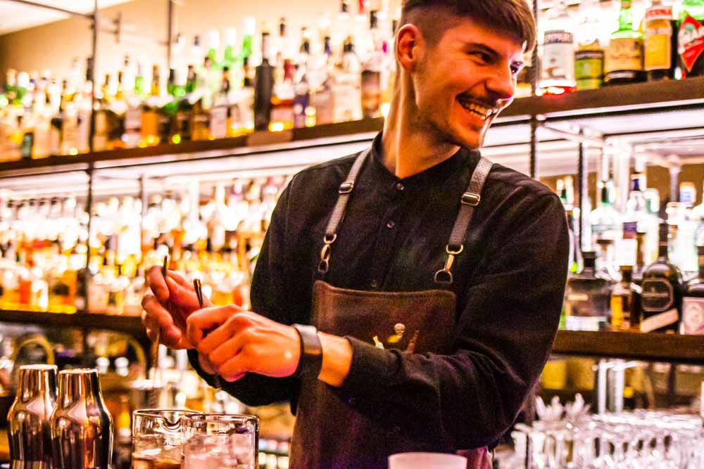 Bartender at The Whisky Shop and Bar by Duokle Angelams in Vilnius