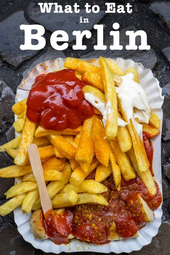 Pinterest image: image of Berlin currywurst with caption reading 'What to Eat in Berlin'