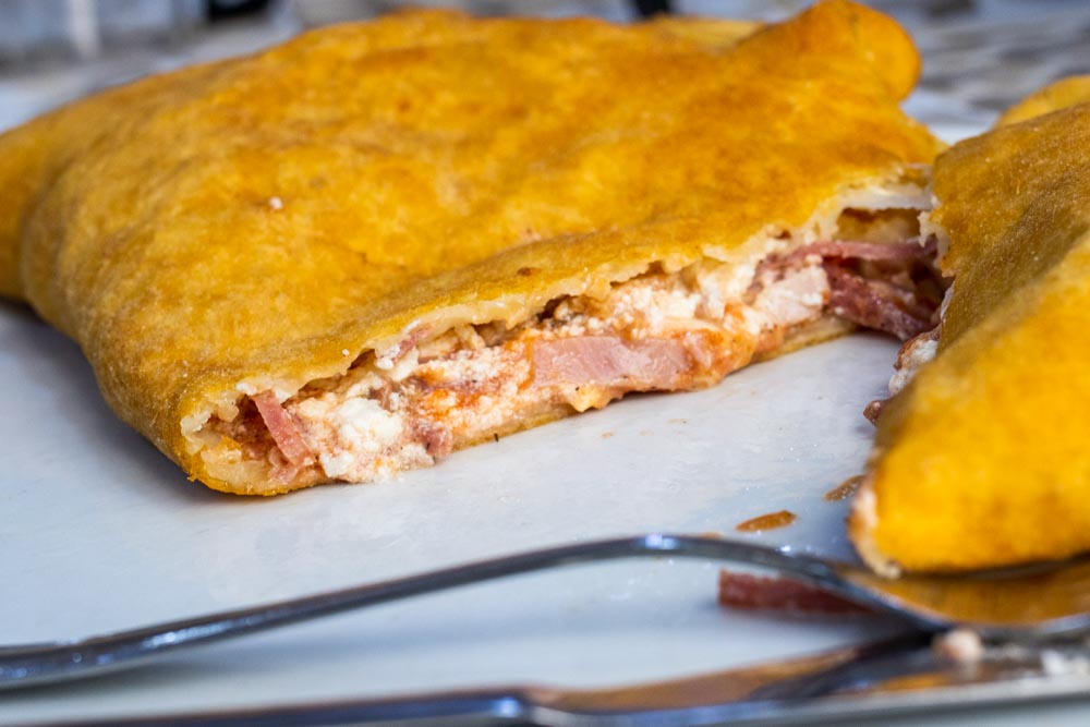 Fried Pizza with Fork at Pizzeria Tutino in Naples