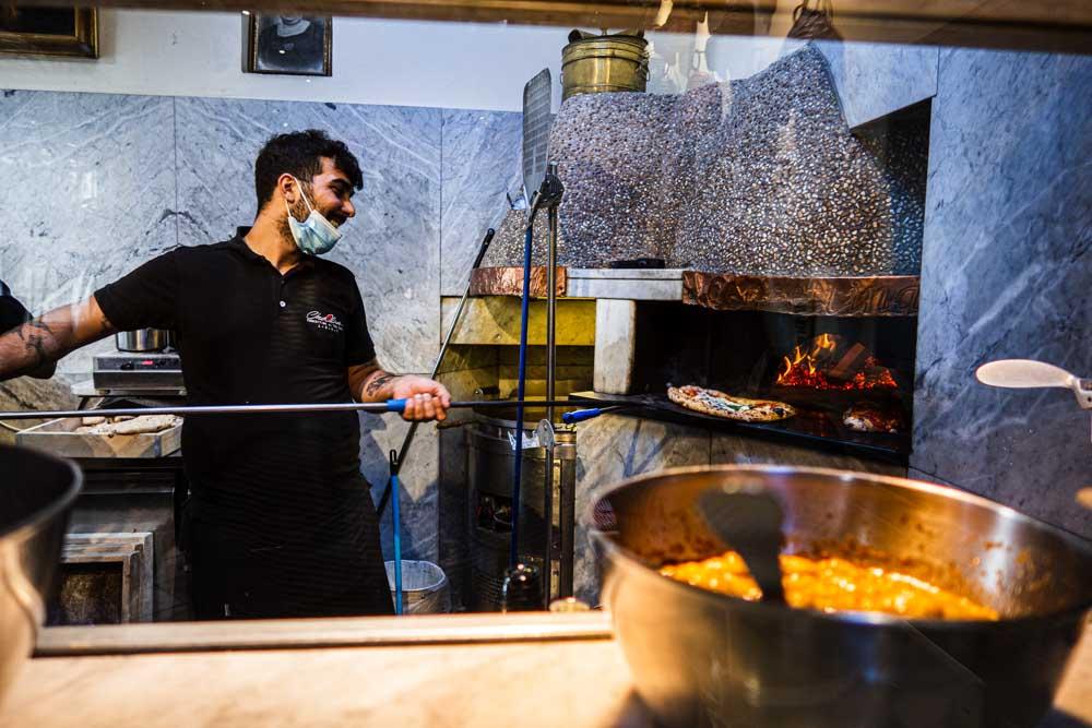 Pizzaiolo at Pizzeria Concettina ai Tre Santi in Naples