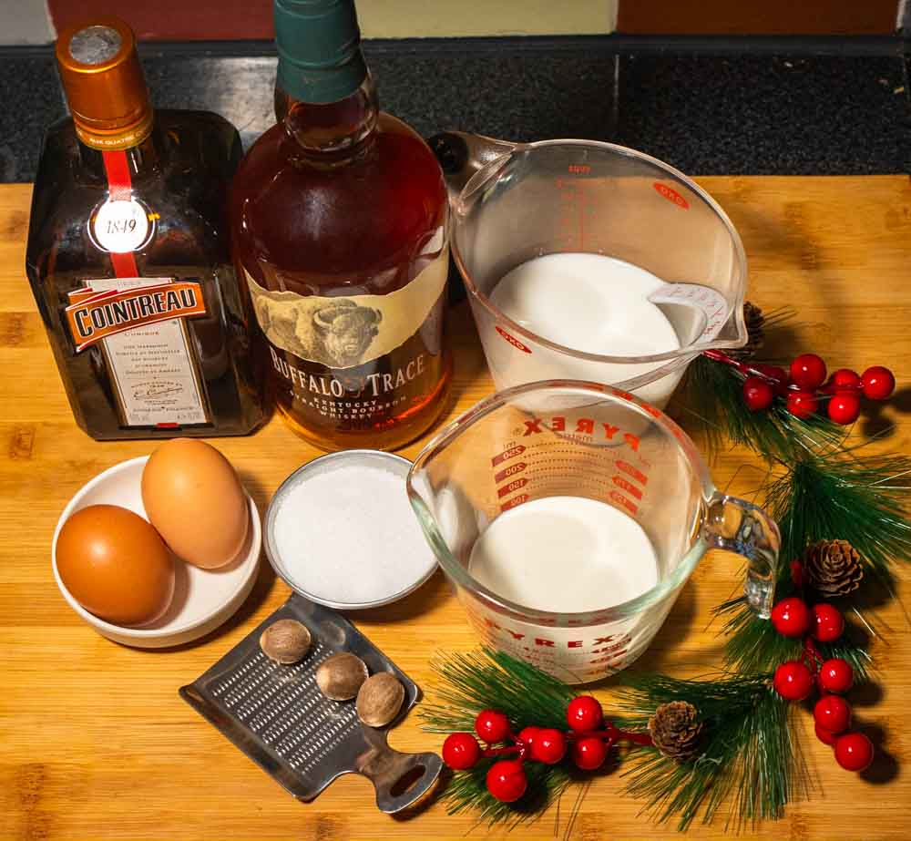 Bourbon Eggnog Ingredients - Cointreau, Bourbon, Whole Milk, Heavy Cream, Sugar, Eggs and Nutmeg