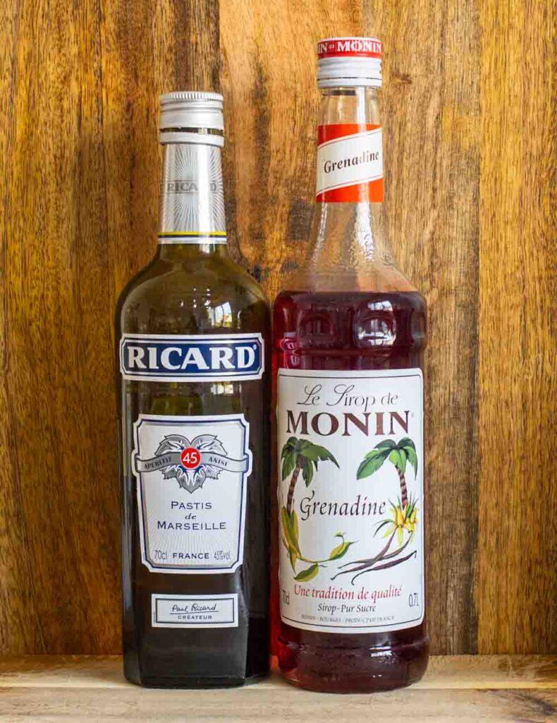 Pastis and Grenadine Bottles